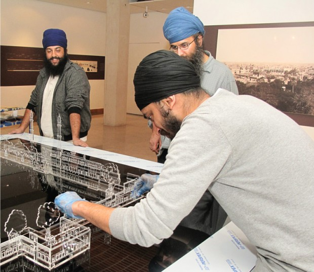 Last minute touches to the Golden Temple model